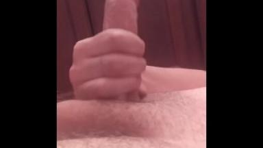Masturbating in bathroom.
