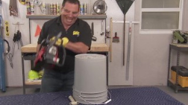 Large man rams long tool into a bucket and screams in pleasure